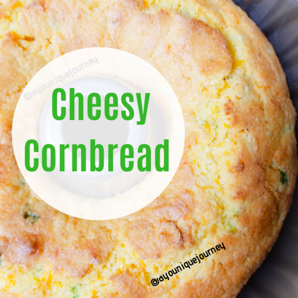 Cheesy Cornbread just finish baking in a Bundt pan.
