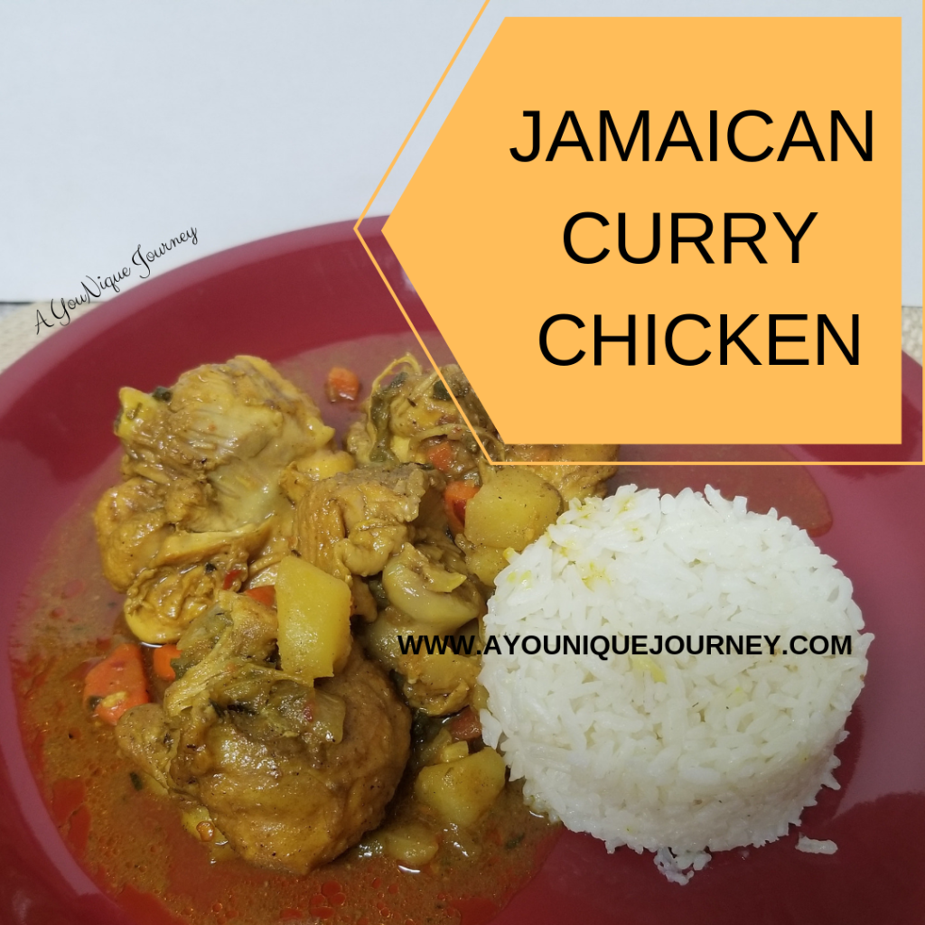 A plate with some Jamaican Curry Chicken and white rice.