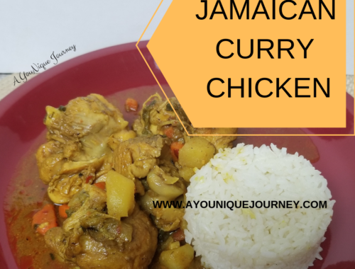 A plate of Jamaican Curry Chicken with white rice.