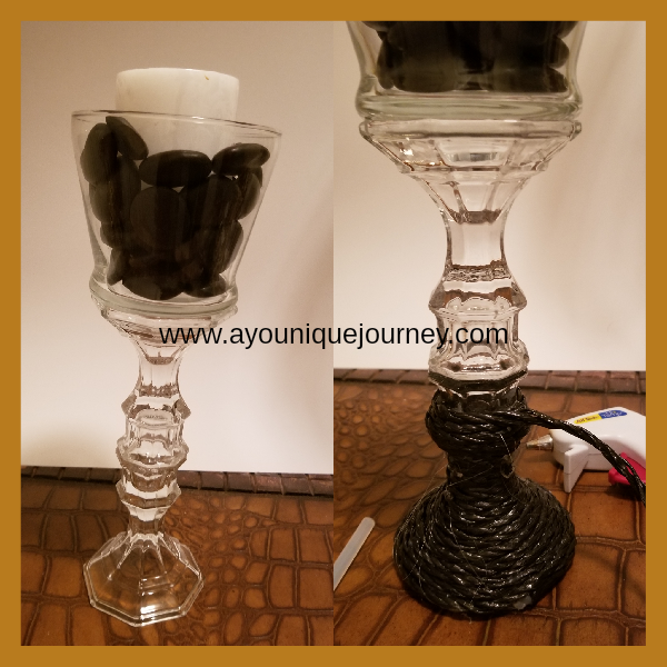 Wrapping the black rope around the candle holders.