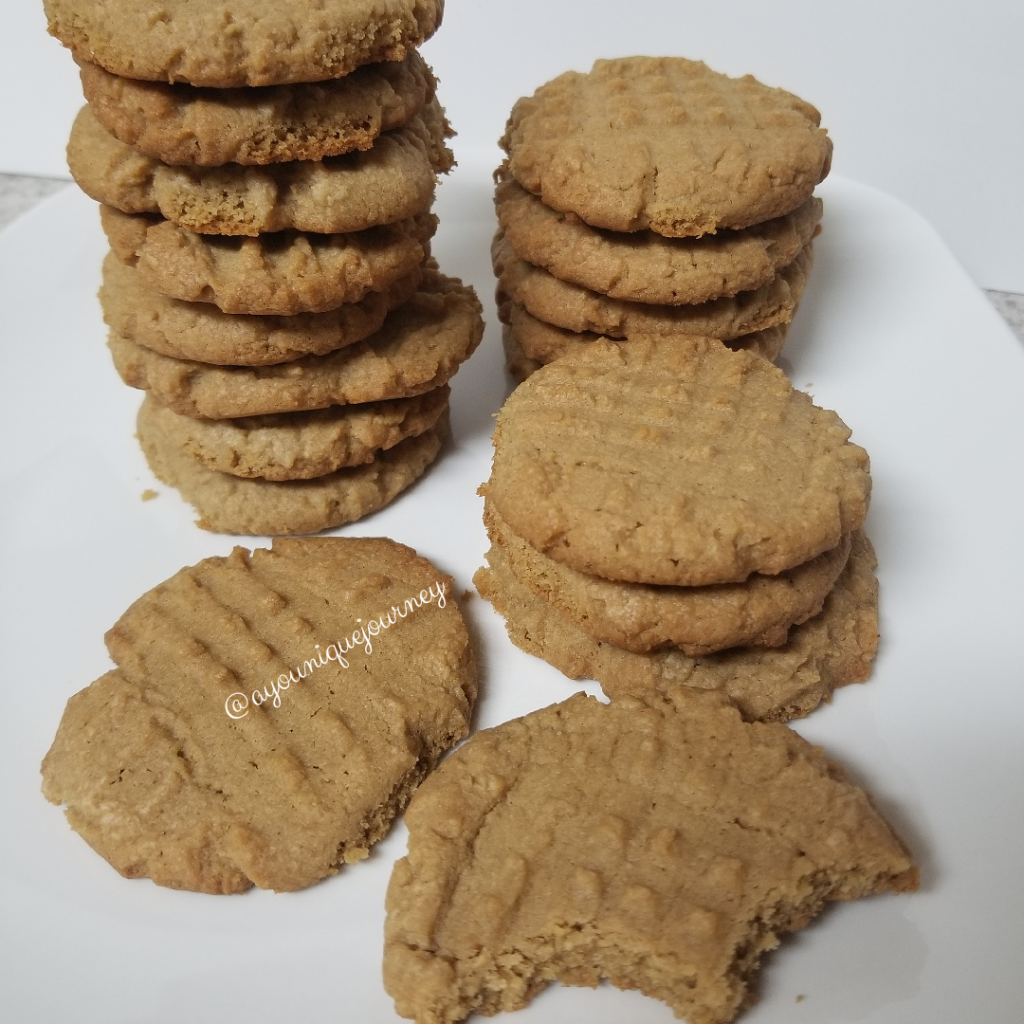 Some Peanut Butter Cookies on a white plate.