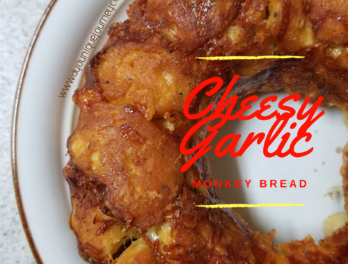 Cheesy Garlic Bread on a cream plate.