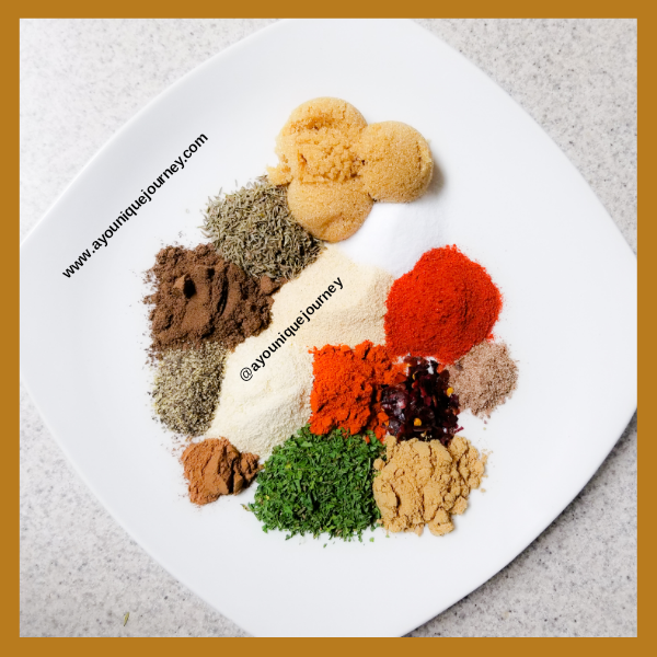 Mixture of different spices and herbs on a plate.