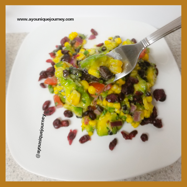 A portion of the Mexican Corn Salad on a white plate.