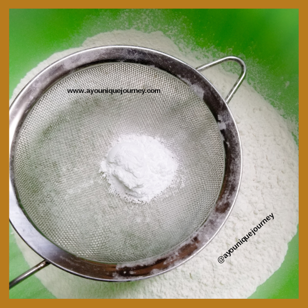Sifting some baking powder to the flour.