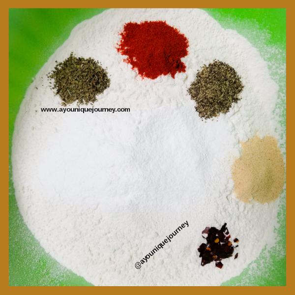 Basil, paprika, black pepper, garlic powder and red pepper flakes (instead of scotch bonnet pepper).