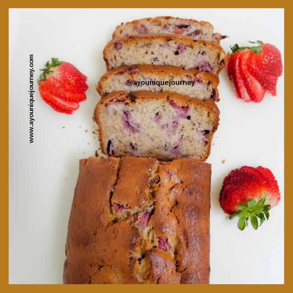 A sliced loaf of Strawberry Banana Bread.