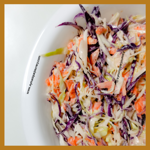 Coleslaw ready to be served in a white bowl.