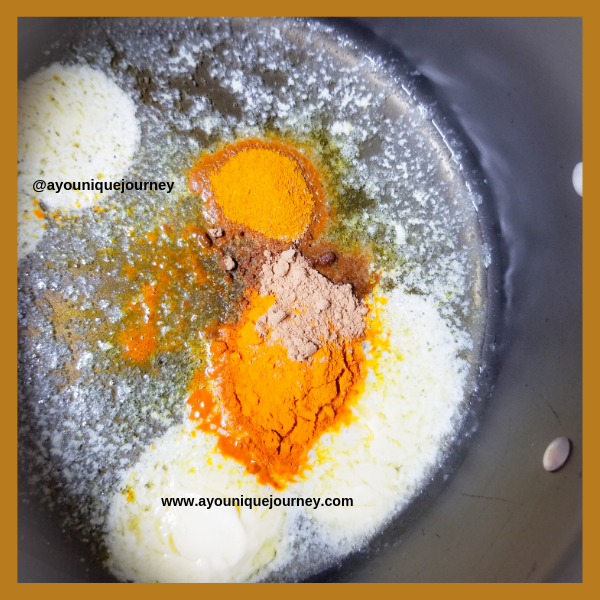 The tumeric powder, curry powder and ground ginger added to the melted butter and coconut oil.