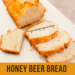 Slicing up the Honey Beer Bread on a white cutting board.