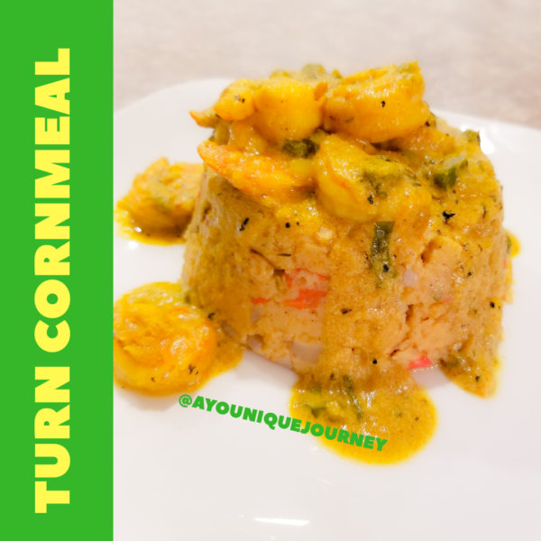 A serving of Turn Cornmeal with some Coconut Curry Shrimp on top.