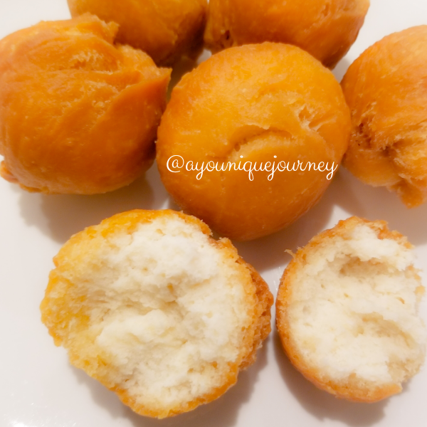 An opened Jamaican Fried Dumplings to show the soft texture inside.