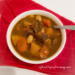 Guinness Beef Stew Recipe in a white bowl.