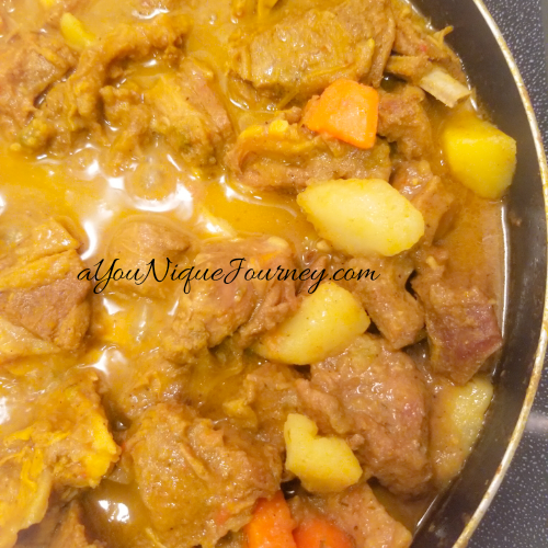 Finalizing the Jamaican Curry Goat Recipe.