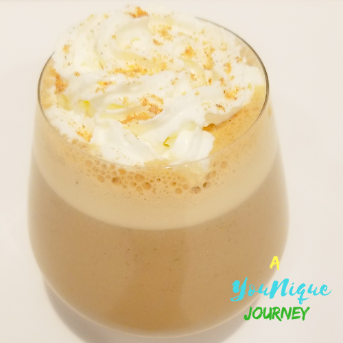 Guinness Punch with whipped cream and grated nutmeg.