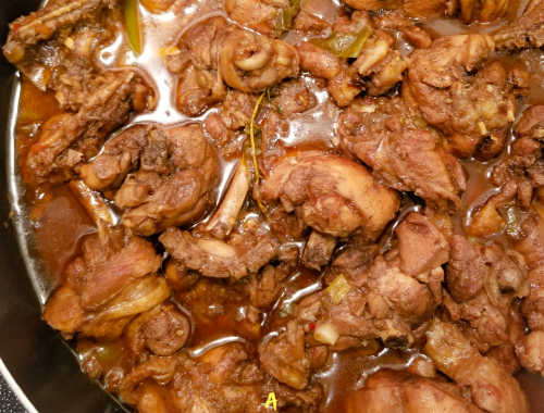 Jamaican Brown Stew Chicken in a large skillet.