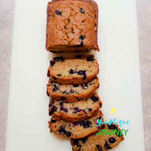 A sliced loaf of Blueberry Zucchini Bread.