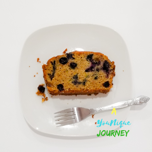 One slice of Blueberry Zucchini Bread on a white plate