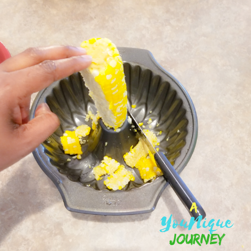 Cutting off the kernels.
