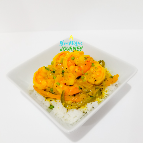Coconut Curry Shrimp served with white rice in a white bowl.