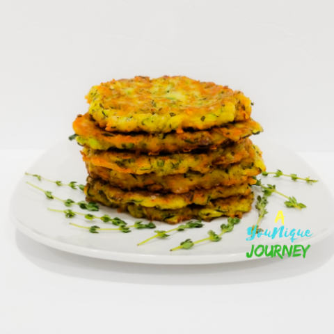 Zucchini Fritters on a white plate.