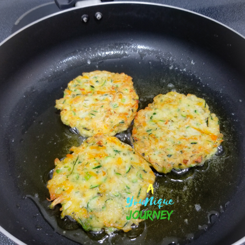 Frying the Zucchini Fritters.