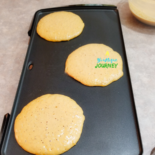 Pumpkin Pancakes ready to flip on the other side.