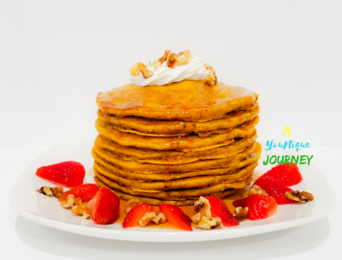 Pumpkin Pancakes with strawberries and nuts.