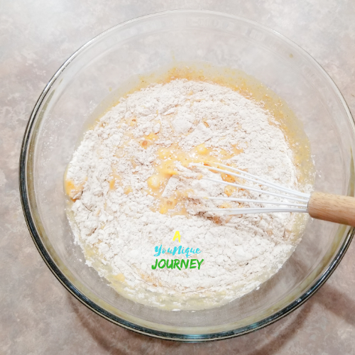 Mixing the wet ingredients with the dry ingredients to make the Pumpkin Pancakes batter.