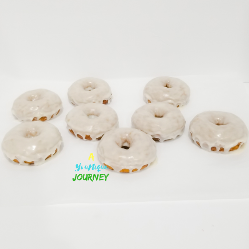 Baked Pumpkin Donuts with the vanilla glaze dripping.