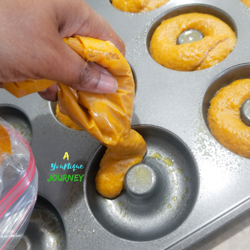 Add the pumpkin batter into each donut cups to make the baked pumpkin donuts.