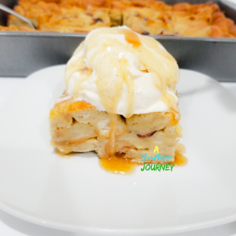 Eggnog Bread Pudding Recipe with a scoop of vanilla ice cream drizzled with rum sauce.
