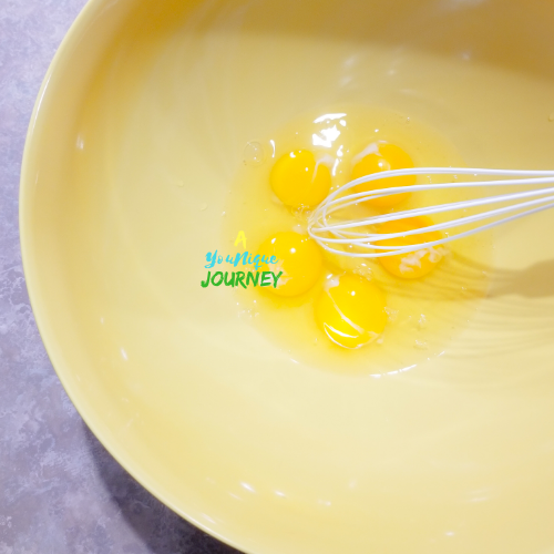 Whisking the eggs.