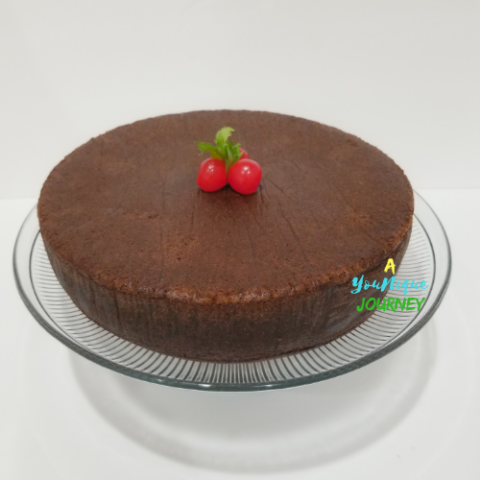 Jamaican Black Fruit Cake with cherries on the top.