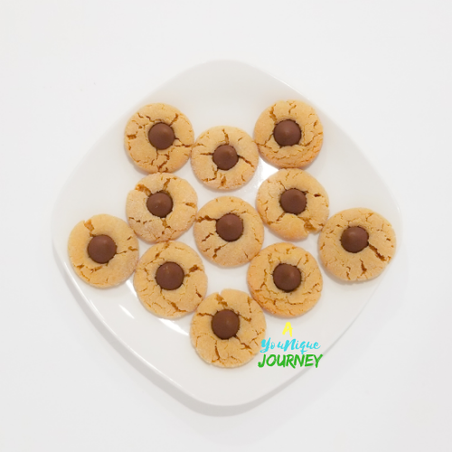 Peanut Butter Blossoms on a white plate.