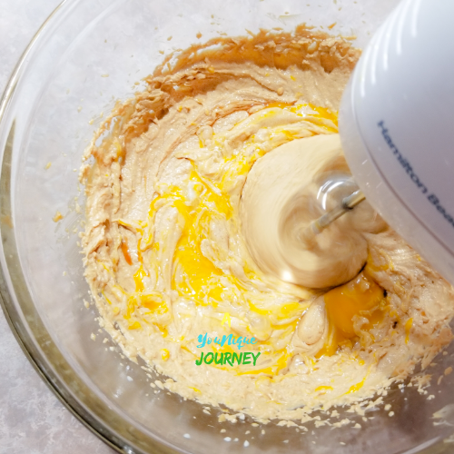 Mixing the wet ingredients for the Peanut Butter Blossoms cookie dough.