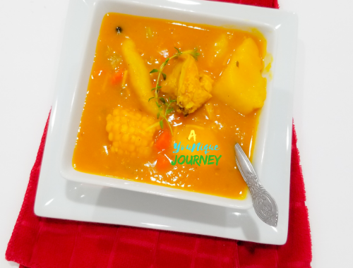 A bowl of Jamaican Chicken Pumpkin Soup.