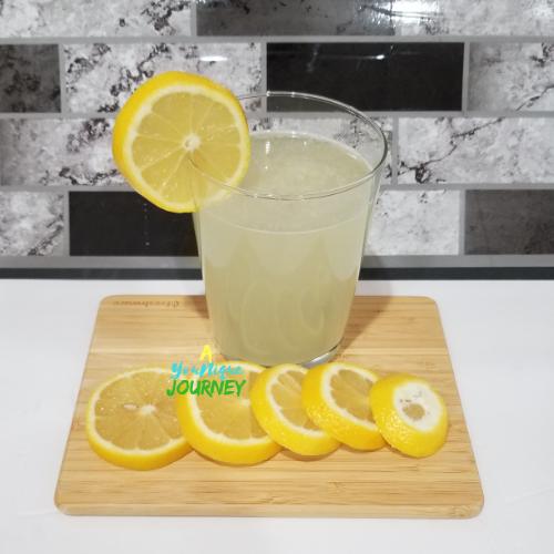 A glass full of lemonade.