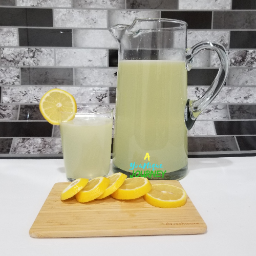 Lemonade Recipe in a glass pitcher.