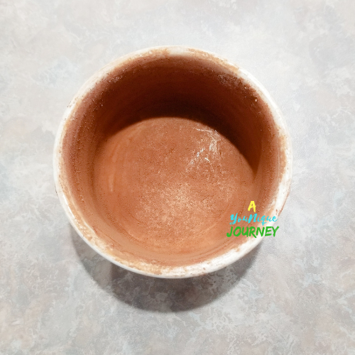 Prepared ramekin that was greased with butter and dusted with chocolate powder.