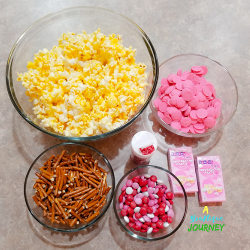 All the ingredients to make the Valentine's Day Popcorn Mix.