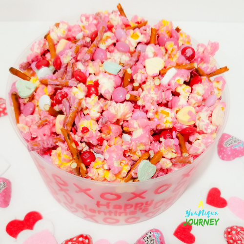 Valentine's Day Popcorn Mix in a plastic bowl.