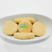 Jamaican Boiled Dumplings in a white serving dish.