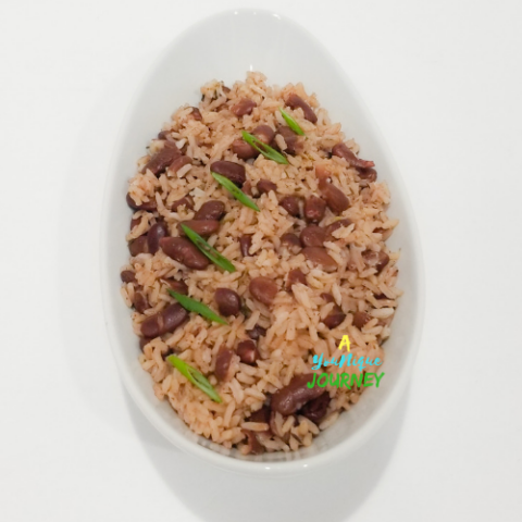 A white bowl with Jamaican Rice and Peas,