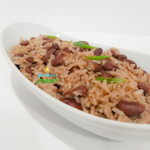 A closer look at Jamaican Rice and Peas in a white serving bowl green onion on top.