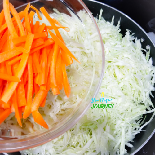 Adding the carrots to the mixture.