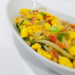Jamaican Ackee and Saltfish in a white serving bowl.