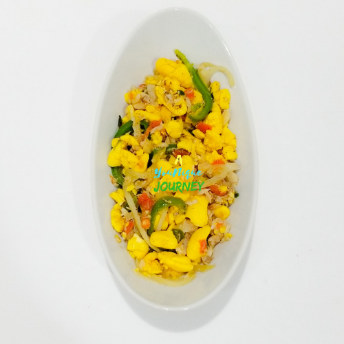 Ackee and Saltfish in a white serving bowl.