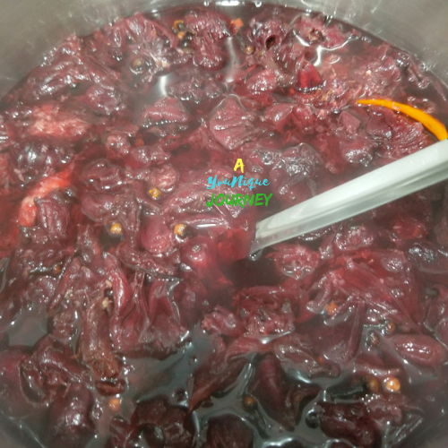 Jamaican Sorrel Drink with spices coming to a boil.