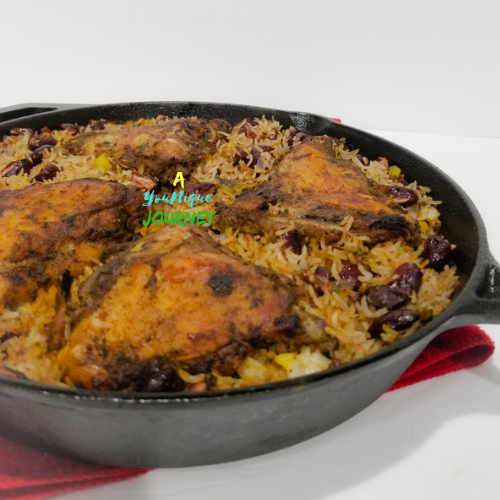 A close up of the finished meal of the one pan Jerk Chicken with Rice and Peas one pot meal.